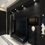 Прихожая оформленная в черном цвете с кожаным диваном