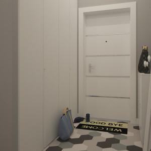 Широкая белая входная дверь в прихожей в скандинавском стиле