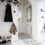 Проем в виде арки для небольшой прихожей в стильном скандинавском дизайне