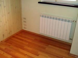 Установленный в квартире алюминиевый радиатор