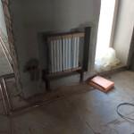 Процесс монтажа радиаторов