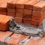 Подготовка к процессу кладки кирпичной стены